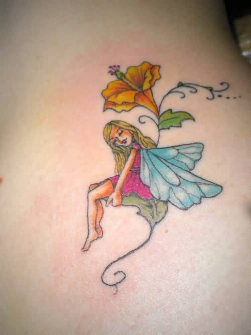 sweet blue wings fairy tattoo design with lovely yellow flower. Black Bedroom Furniture Sets. Home Design Ideas