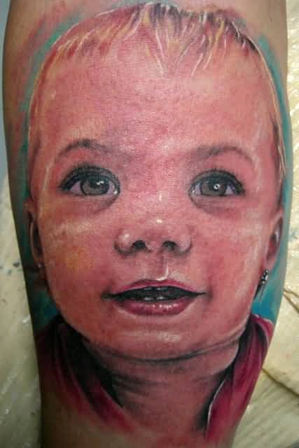 Sweet Little Baby Boy Face Tattoo Design Made By Ink