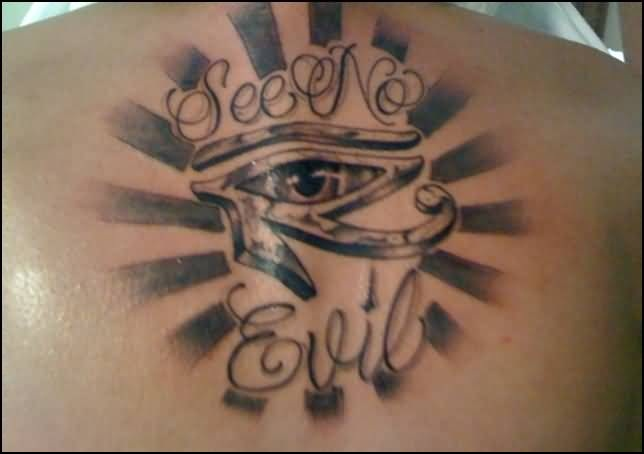 Upper Back Decorated With Outstanding Rising Sun Egyptian Eye With Evil Text Tattoo