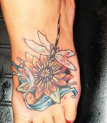 Women Foot Decorated With Outstanding Classy Dragonfly And Nice Flower Tattoo