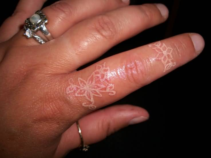 Women Show Brilliant Flower Tattoo Design Image Make On Side Finger