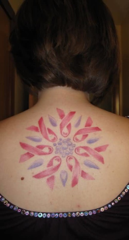 Women Show Wonderful Colorful Feminine Bows Tattoo On Upper Back