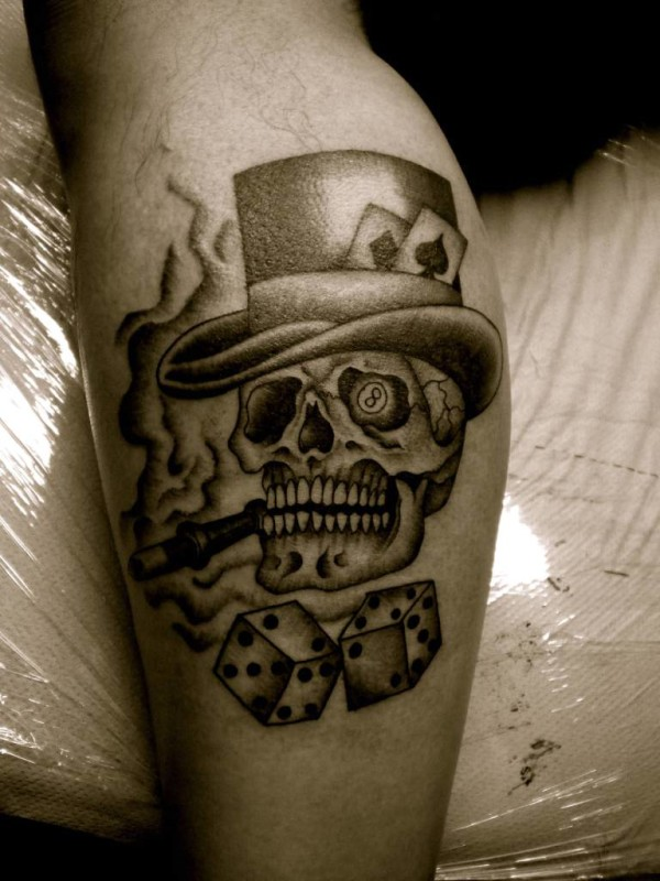 Angry Skull And Gambling Dice Tattoo Design For Men On Leg