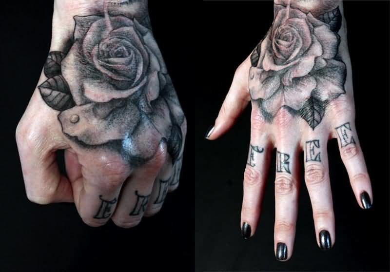 Beautiful Flowers And Nice Text Tattoo On Hand For Cool Women