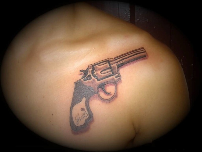 Brilliant Chest Cover Up With Outstanding Gun Tattoo