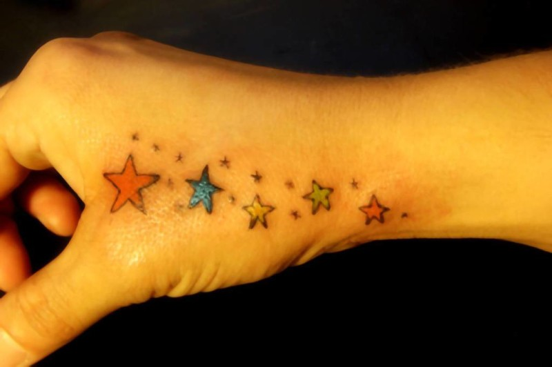 Colorful Nice One Stars Tattoo Design Image Make On Side Hand
