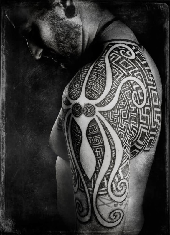 Coolest Men Show Traffic Greek Tattoo On Upper Sleeve