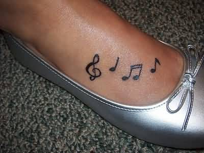 Lovely Black Ink Music Notes Tattoo Design Image Make On Foot