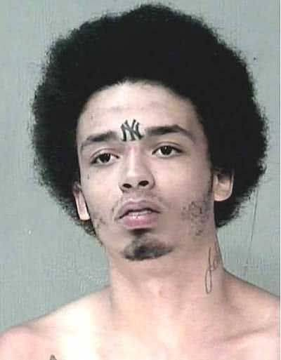 Cross tattoo on forehead pictures to pin on pinterest for Cross tattoo on forehead meaning