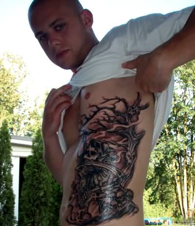 Men Show Angry Grim Graveyard Tattoo Design Image Make On Rib Side