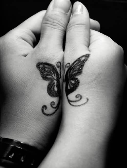 Simple Black Ink Butterfly Tattoo On Side Hand For Cool Women