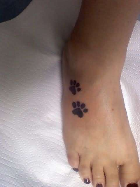 Women Foot Cover Up With Outstanding Classy Black Dog Footprint Tattoo