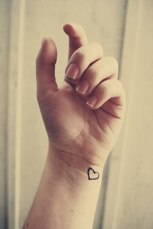 Black ink simple small heart tattoo on wrist for Small heart tattoos on wrist