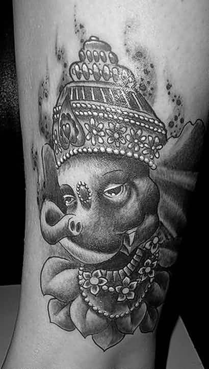 Coolest Black And White Ink Lord Ganesha Face Tattoo Design Image