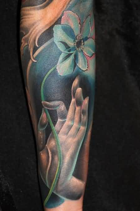 Fantastic Hand And Lovely Flower Tattoo Design