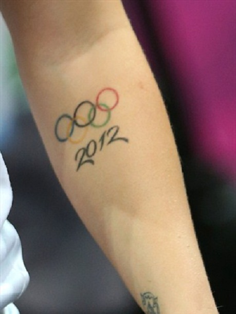 Lower Sleeve Amazing Famous Olympic Symbol With 2012 Text Tattoo