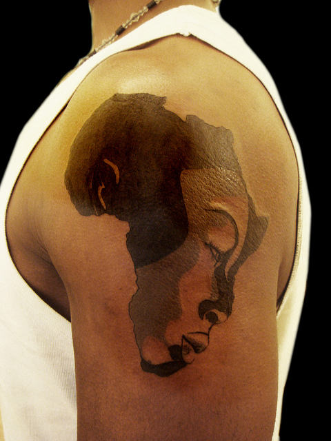 Men Show Coolest African Queen Girl Face In Map Tattoo