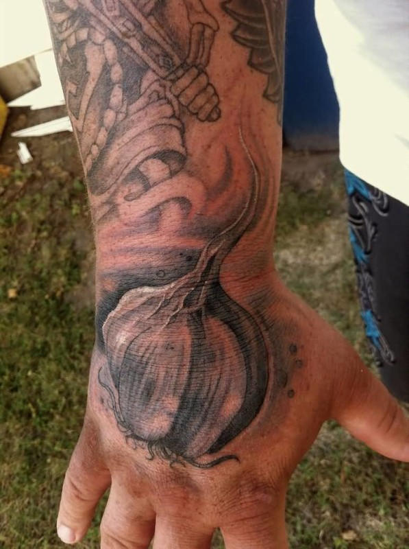 Men Show Wonderful Garlic Tattoo Make On Hand