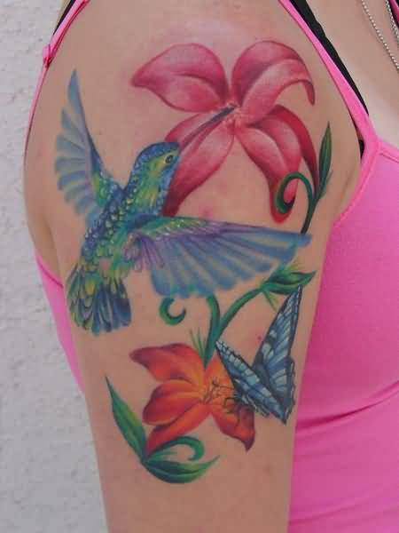 Pretty Hot Women Show Simple Flower And Cool Flying Butterfly With Hummingbird Tattoo