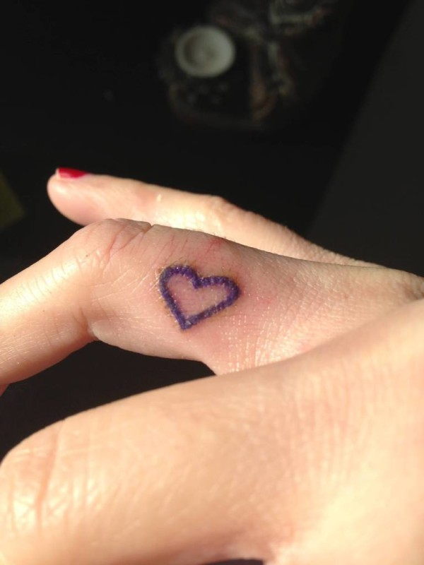 Simple Small Heart Tattoo Design Image Make On Women's Ring Finger
