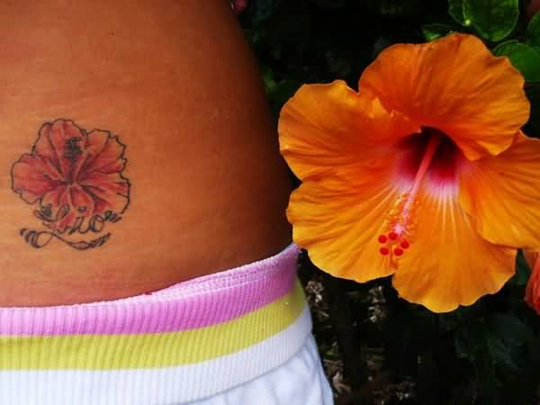 Small Hibiscus Flower Tattoo Design Image Make On Lower Side Back