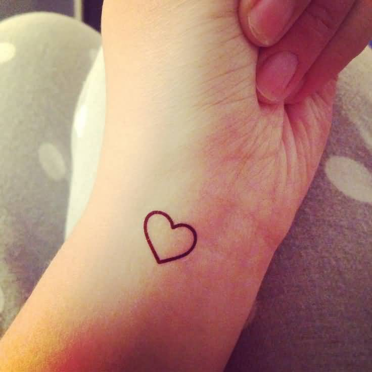 Small Lovely Heart Tattoo Design Image Make On Women's Wrist
