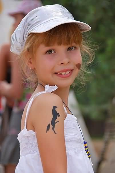 Sweet Girl Show Nice Simple Play Boy Horse Tattoo On Upper Sleeve