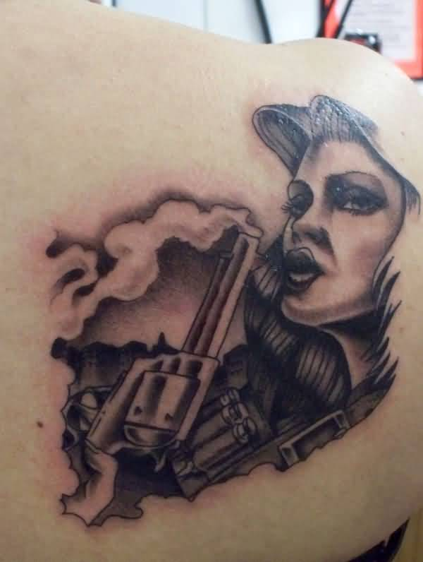 Upper Side Back Decorated With Outstanding Gangsta Girl And Old Gun Tattoo Design