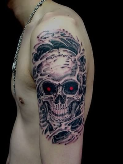 Upper Sleeve Decorated With Red Eye Skull Tattoo Design