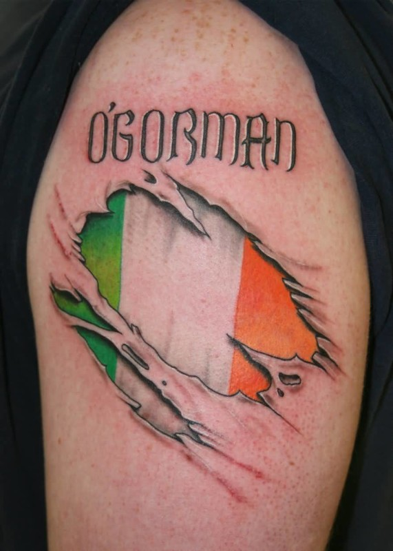 Awesome Ripped Skin Upper Sleeve Irish Flag Tattoo