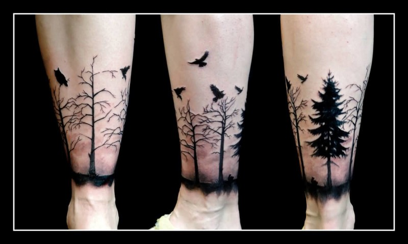 Black Flying Birds And Cool Forest Tree Tattoo On Leg