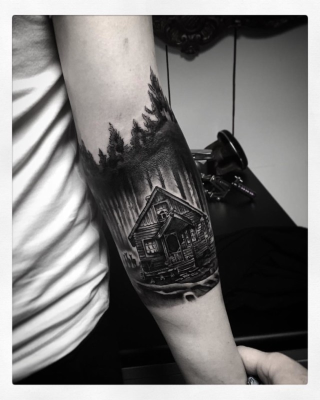 Forest House In Tree Area Tattoo On Lower Arm