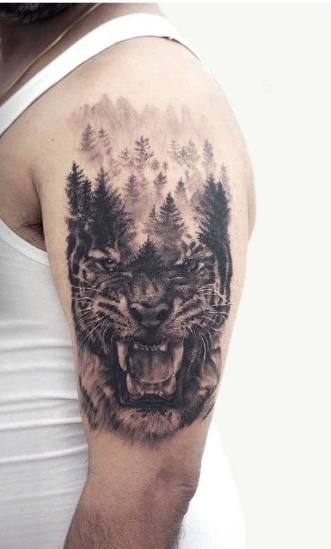 Men Show Aggressive Tiger Face Forest Tattoo