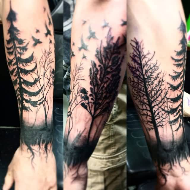 Sweet Flying Birds And Nice Lower Arm Forest Tree Tattoo