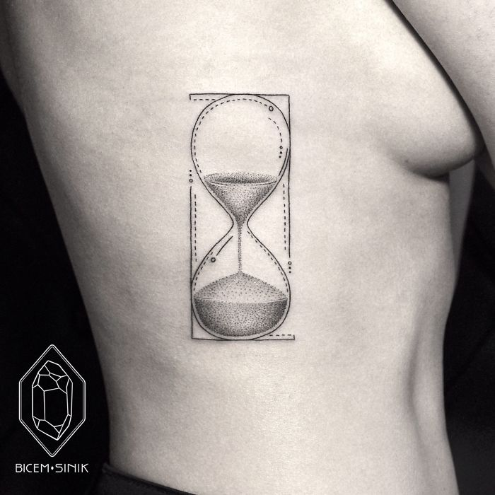 Amazing Simple Dotwork Sandclock Tattoo