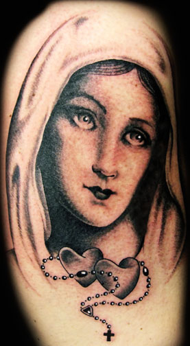 Attractive Black And Grey Ink Saint Mary Mother Of God Face With Rosary Heart And Cross Tattoo