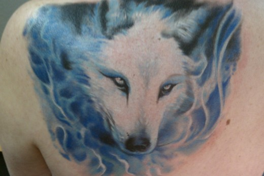 Awesome Dangerous Angry White Ink Wolf Face Tattoo On Back Of Shoulder