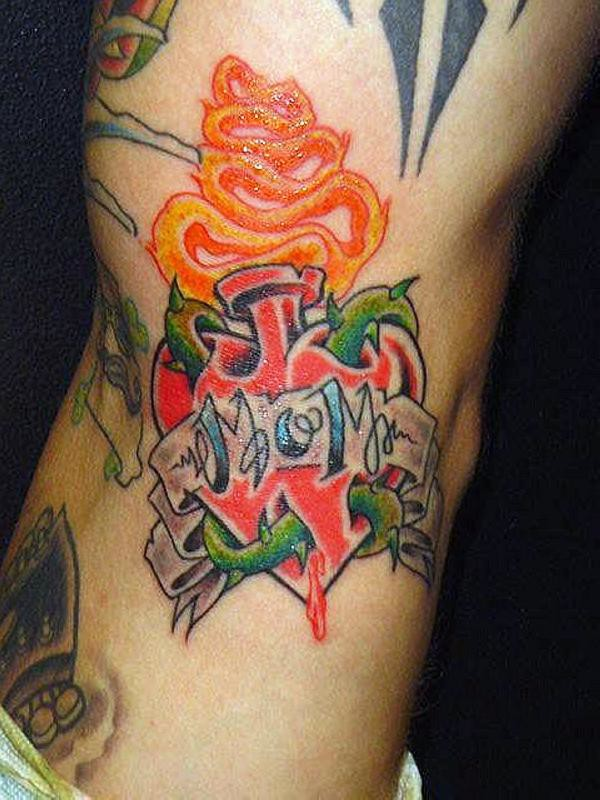 Burning Heart With Mom Banner Tattoo On Lower Back