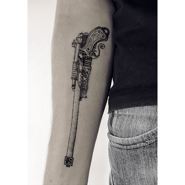 Classy Cool Lower  Sleeve Dotwork Gun Tattoo Design
