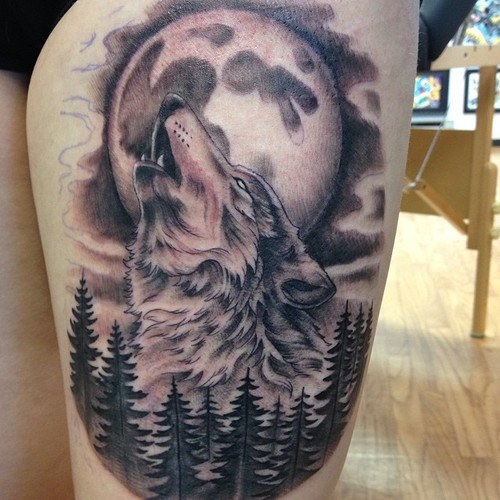Forest Trees With Roaring Wolf And Full Moon Tattoo On Thigh