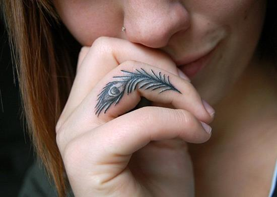 Girl Show Black Ink Peacock Feather Tattoo On Finger