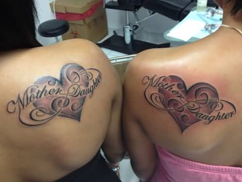 Girl Showing Her Mother Daughter Heart Tattoo On Back Of Shoulder