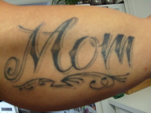 Grey Ink Simple Mom Text Tattoo On Bicep
