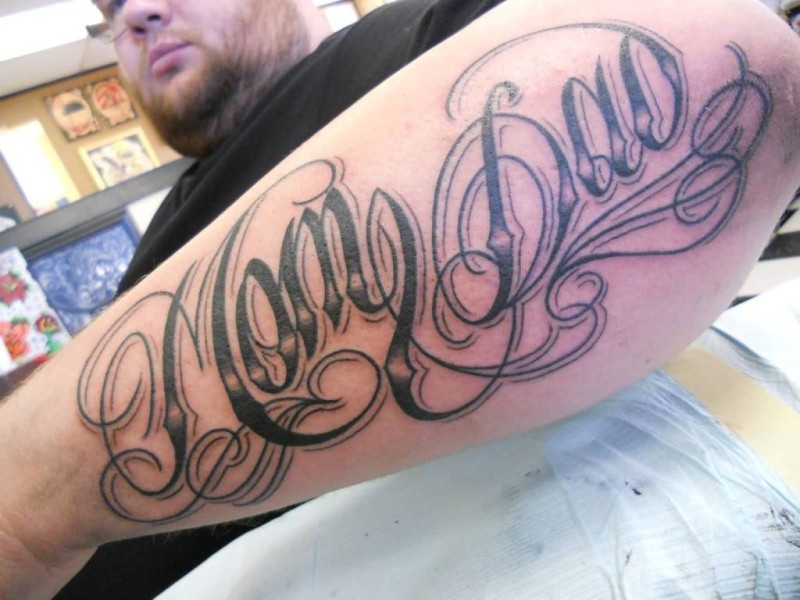 Handsome Cool Men Show Nice Mom Dad Tattoo On Lower Arm