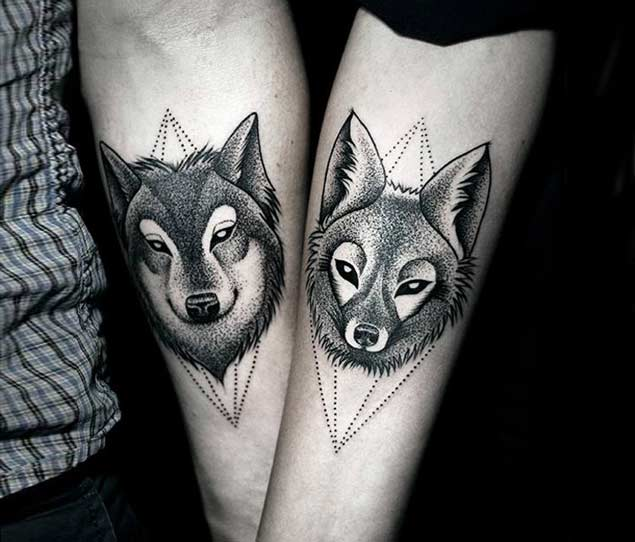 Nice Dotwork Lower Arm Boyfriend And Girlfriend Wolf Faces Tattoo