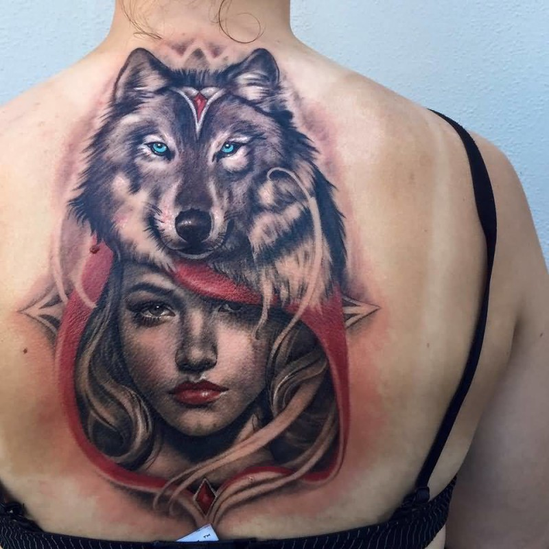 Nice Girl Face With Awesome Wolf Face Tattoo On Girl Back