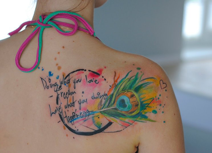 Nice Text And Watercolor Peacock Feather Tattoo Design
