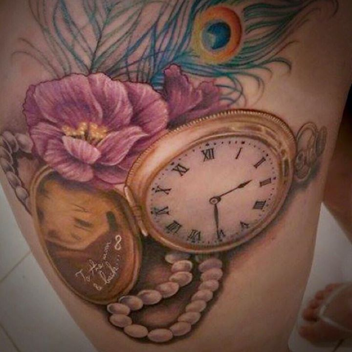 Peacock Feather With Flower And Clock Tattoo
