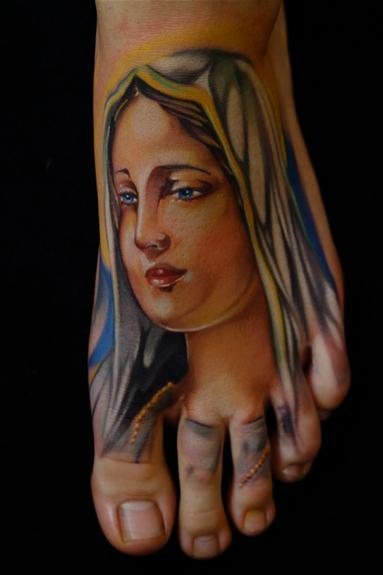 Reliogious Realistic Colorful God Saint Mary Mother Face Tattoo On Foot