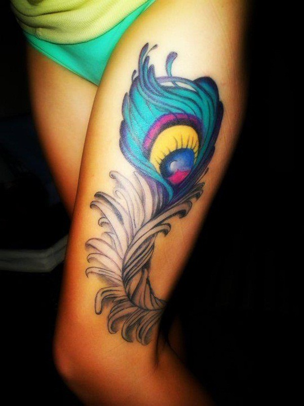 Wonderful Cool Peacock Feather Tattoo Design Idea For Thigh